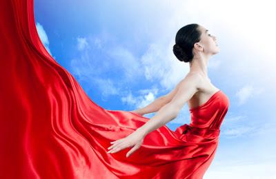 beautiful young woman in red long dress